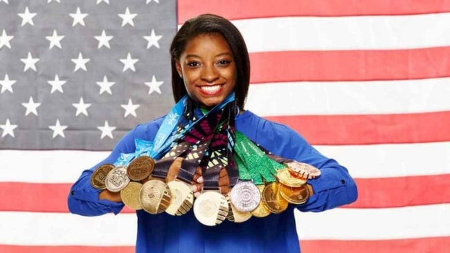 Standing for Olympic Gold Champion Simone Biles