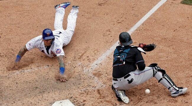 Baez scores winning run as Mets stun Marlins with comeback in ninth