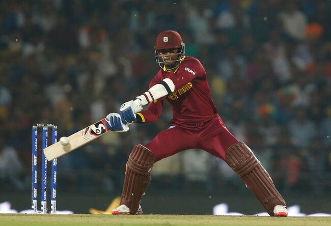 Cricket-Former West Indies all-rounder Samuels charged with alleged corruption