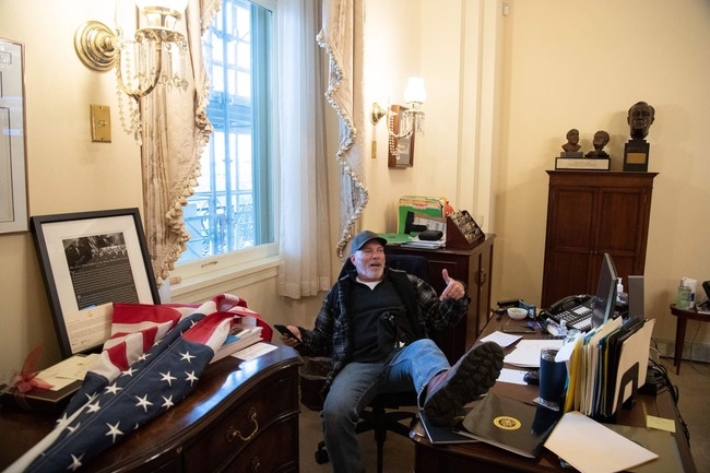 Man photographed with foot on desk in Pelosi's office released from jail pending trial in Jan. 6 Capitol riot