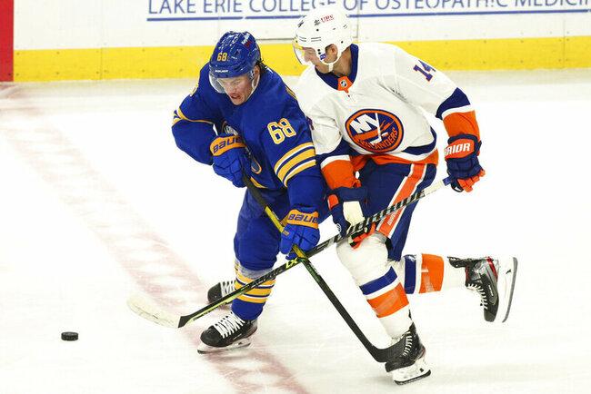 Houser wins in NHL debut as Sabres rally past Islanders 4-2