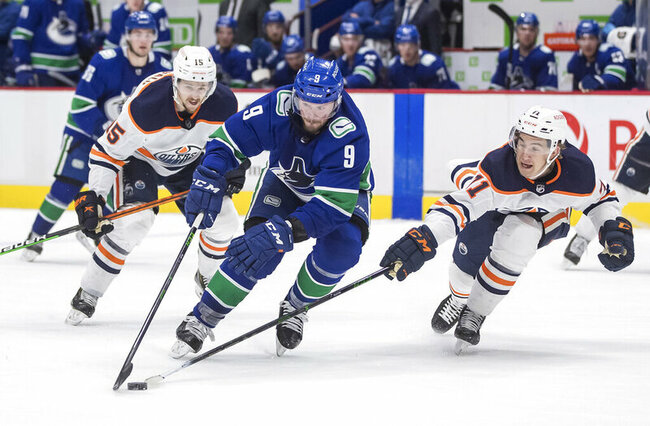 McDavid help Oilers beat Canucks 5-3 to clinch playoff spot
