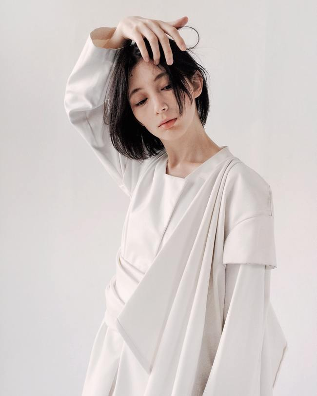 Woman in White Long-sleeved Dress