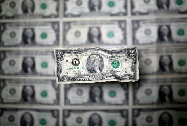 Dollar holds near two-week high, U.S. jobs data eyed for Fed clues